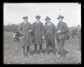 Four unidentified men outdoors, full-length portrait