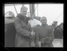William C. Crawford, pilot, and unidentified aviator