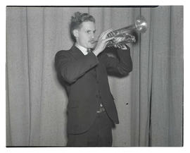Young man playing trumpet