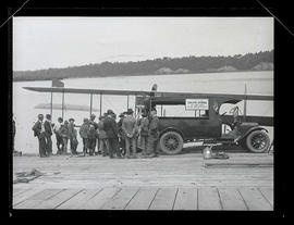 Group of people watching as seaplane is loaded for Oregon Journal delivery