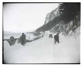 Unidentified people shoveling snow on East Multnomah Falls Viaduct, Columbia River Highway