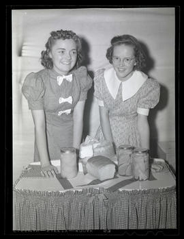 Girls posing with prize-winning food