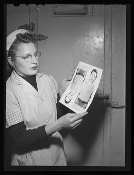 Doris Baker holding photograph of suspected robber in Portland