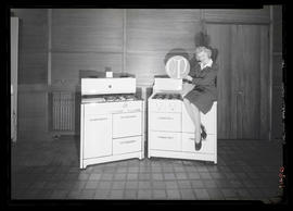 Margaret Hegeberg posing with pair of stoves