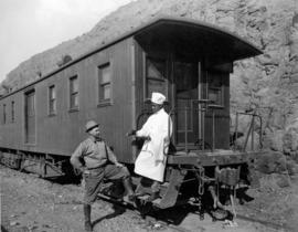 Fred H. Kiser and cook at special studio car provided by the Great Northern Railway