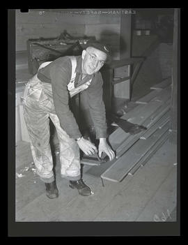 Worker marking a board during graveyard shift, Albina Engine & Machine Works, Portland