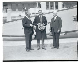 Unidentified man, Schause, and Charles H. Martin at Swan Island airport, Portland
