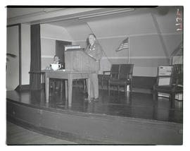 Unidentified man at lectern during convention