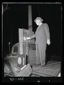 Man standing next to utility pole with lever