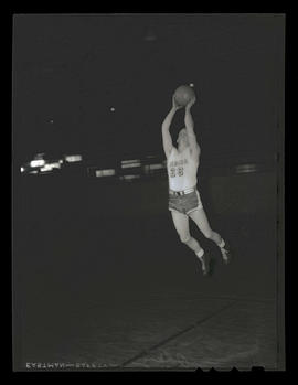 Oberg, basketball player for Albina Hellships, in midair with ball
