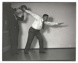 Men posing with bowling ball