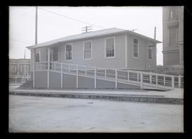 Unidentified wooden building with ramp