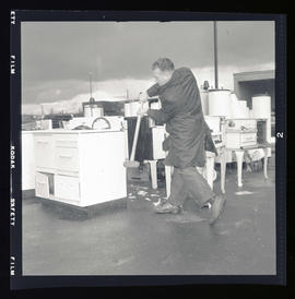 Men smashing ranges at an electric range trade-in at the Portland Service Center