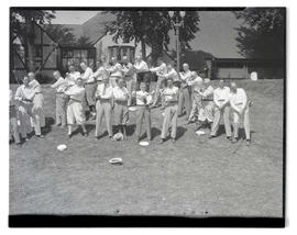 Group of golfers posing near clubhouse