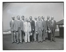 Group of unidentified men on rooftop, full-length portrait