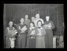 Albina Engine & Machine Works employees holding boxes of cigarettes for U. S. troops