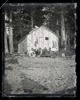 Men beside a cabin