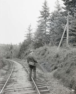 Herman Bohlman walking down railroad tracks