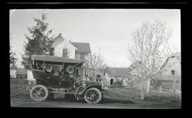 Automobile in front of house