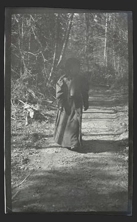 Young girl on a forest path